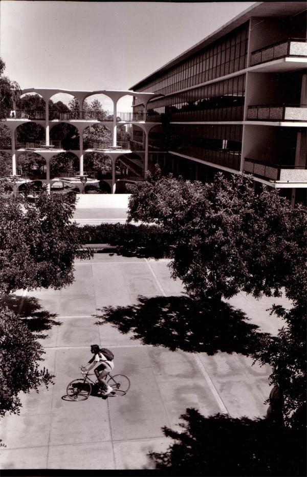 Student bikes past Urey Hall